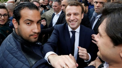 Macron security aide to be fired for beating protester